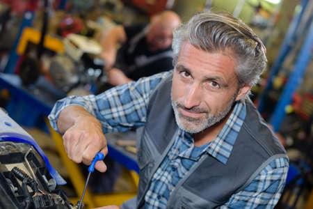 Portrait of senior mechanic