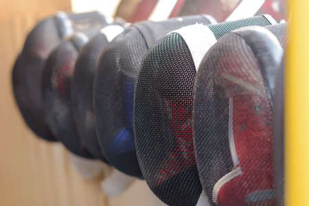 elite: fencing masks hanging Stock Photo