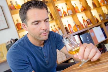 degustating: expert amateur is tasting a great vintage sweet wine