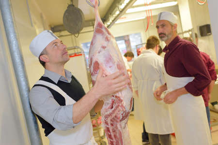 packer: weighing the meat Stock Photo