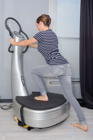 Woman stepping onto fitness machine