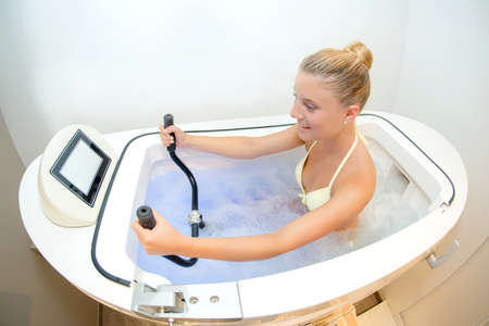 Lady exercising in water bath Stock Photo