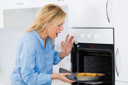 kitchen burn on hand caused by heating oven