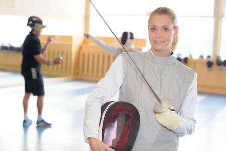 esgrima: Portrait of lady in fencing clothes