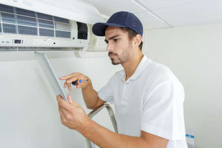 young contractor working carefully and seriously at clients office
