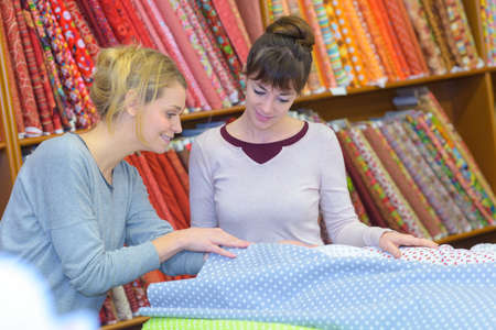 variety: Women in fabric shop Stock Photo