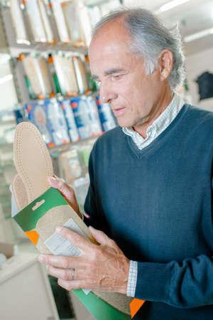 buying: man buying soles