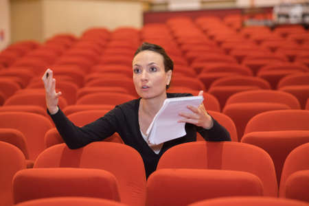 woman directing in a theater