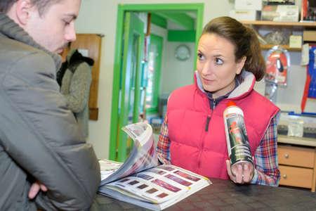 gunk: young entrepreneur buying spray lubricant in hardwarestore Stock Photo