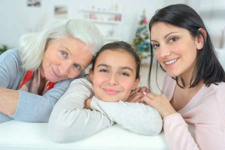 the grand daughter: grandmother with her daughter and grand daughter Stock Photo