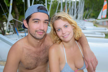 sailing boats: couple on holiday posing for camara on a boat