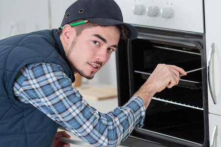 securing: securing an oven
