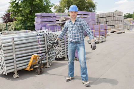 laborer: laborer using a pull cart Stock Photo