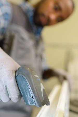 scaner: Closeup of man using handheld scanner