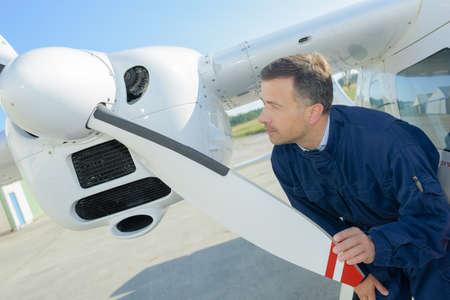 aeronautical: Mechanic checking propellor on aircraft