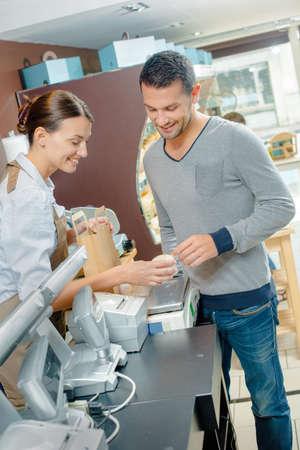checkout: Man at checkout in shop