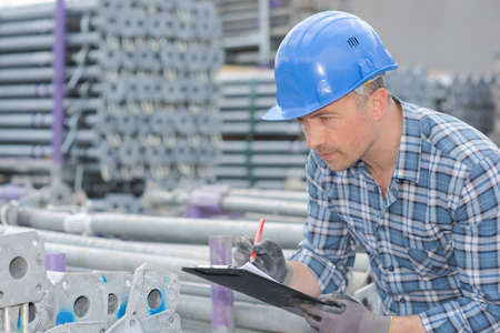worker writing a report Stock Photo