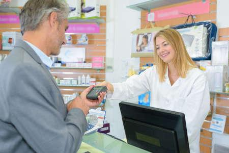 oversee: pharmacist and customer Stock Photo