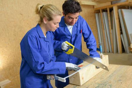 traineeship: workers in carpentry workshop