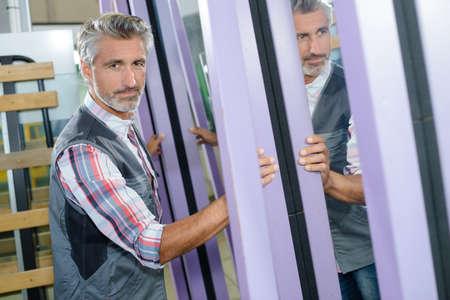 senior men: Portrait of man next to mirrored panels