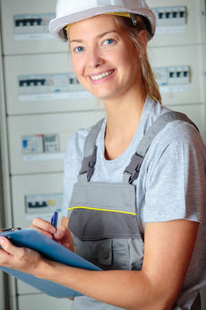 a female electrician Stock Photo