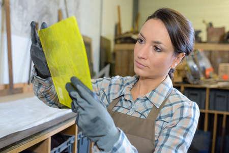 business matter: Artist holding yellow material