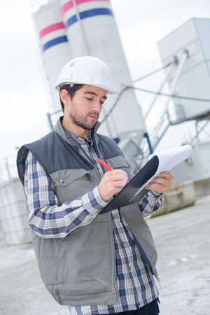 worker writing the information Stock Photo
