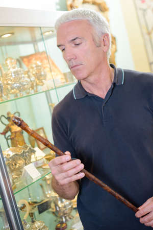 artefacts: old man holding a stick