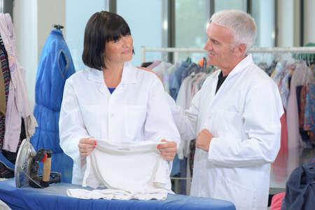 laundrette: Senior couple working in laundrette Stock Photo