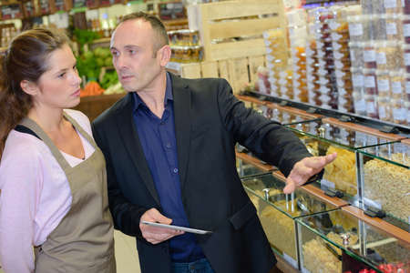 reprimand: Boss giving instructions to shop assistant