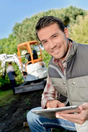 siervo: worker on tablet Foto de archivo