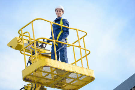 Woman in cherry picker bucket Stock Photo