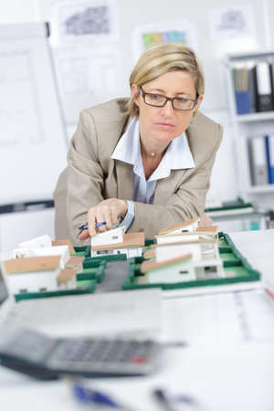 housing lot: inspecting the house models Stock Photo