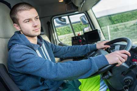moving truck: Young man driving lorry