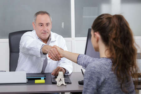 collaborate: doctor shaking hands Stock Photo