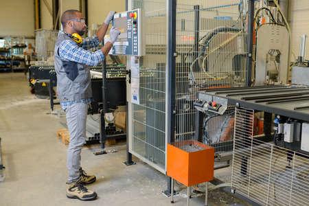 tending: worker tending the machine