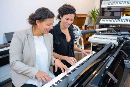 duet: Women playing duet on keyboard