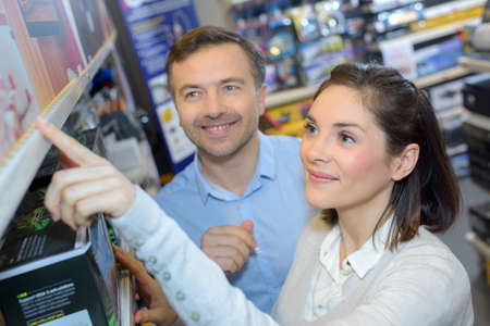 salesgirl: couple shopping in store Stock Photo