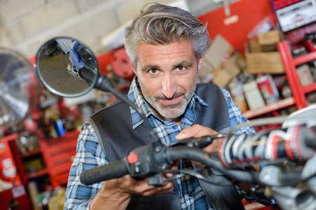 small engine mechanic at work Stock Photo