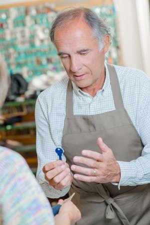 Locksmith holding a key Stock Photo