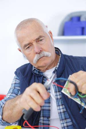 laborer: senior laborer in blue work wear