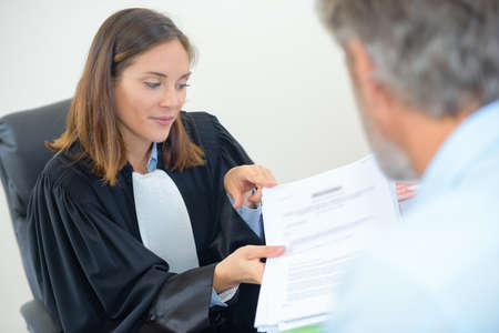 female lawyer: Female lawyer in meeting with male client