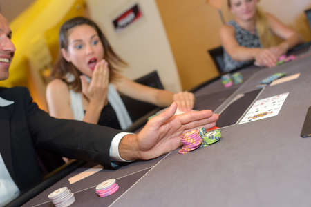 casino table: People around casino table