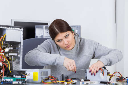 assembler: electronic equipment assembler Stock Photo