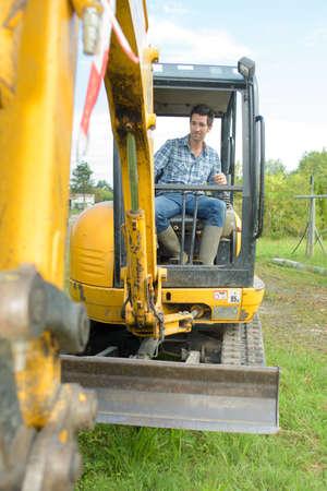 heavy equipment operator: operating a backhoe
