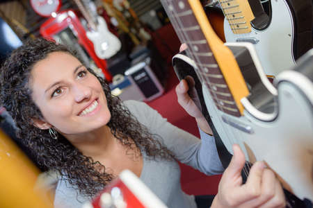 testing the guitar strings Stock Photo