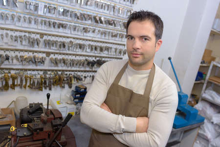 locksmith in his shop Stock Photo