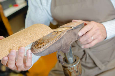 cobbler: Cobbler restoring worn shoe Stock Photo