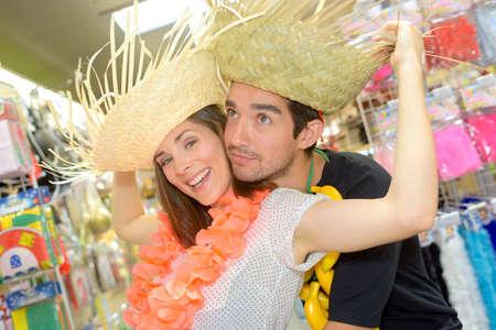 portrait of happy couple having fun trying costumes Stock Photo