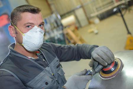 sander: Man using sander Stock Photo
